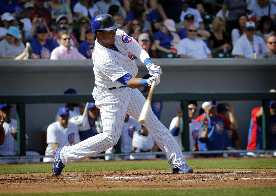 Photo - Chicago Cubs' Starlin Castro connects for a base hit against the Arizona Diamondbacks during the first inning of a spring training baseball game, Thursday, Feb. 27, 2014, in Mesa, Ariz. (AP Photo/Matt York)