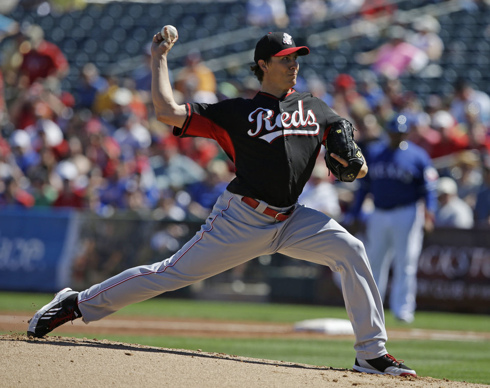 Photo - Cincinnati Reds starting pitcher Homer Bailey throws during the first inning of a spring exhibition baseball game, Monday, March 10, 2014, in Suprise, Ariz. (AP Photo/Darron Cummings)