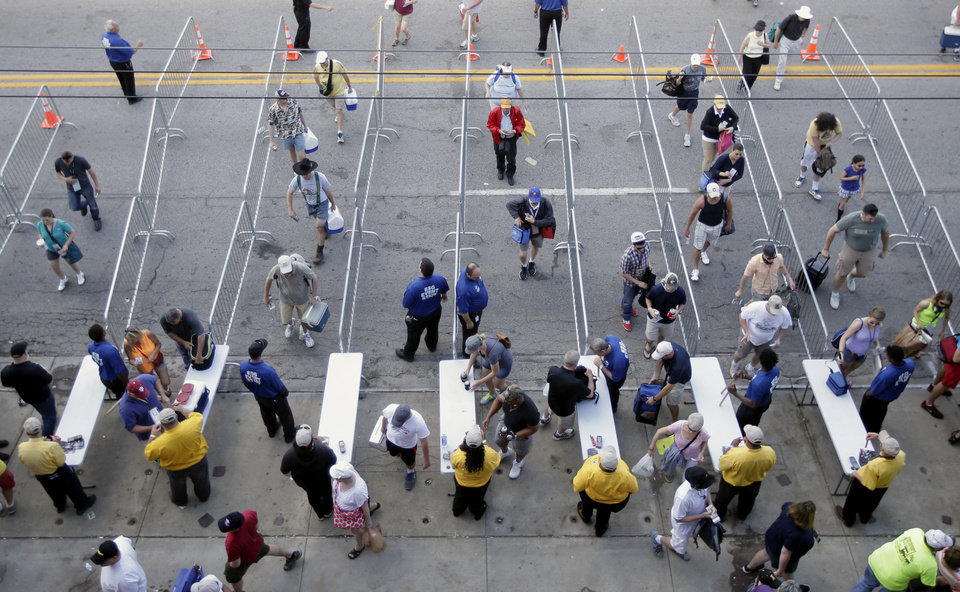 Photo - Fans make their way though a security checkpoint as they enter the Indianapolis Motor Speedway before the start of the 98th running of the Indianapolis 500 IndyCar auto race in Indianapolis, Sunday, May 25, 2014. (AP Photo/AJ Mast)