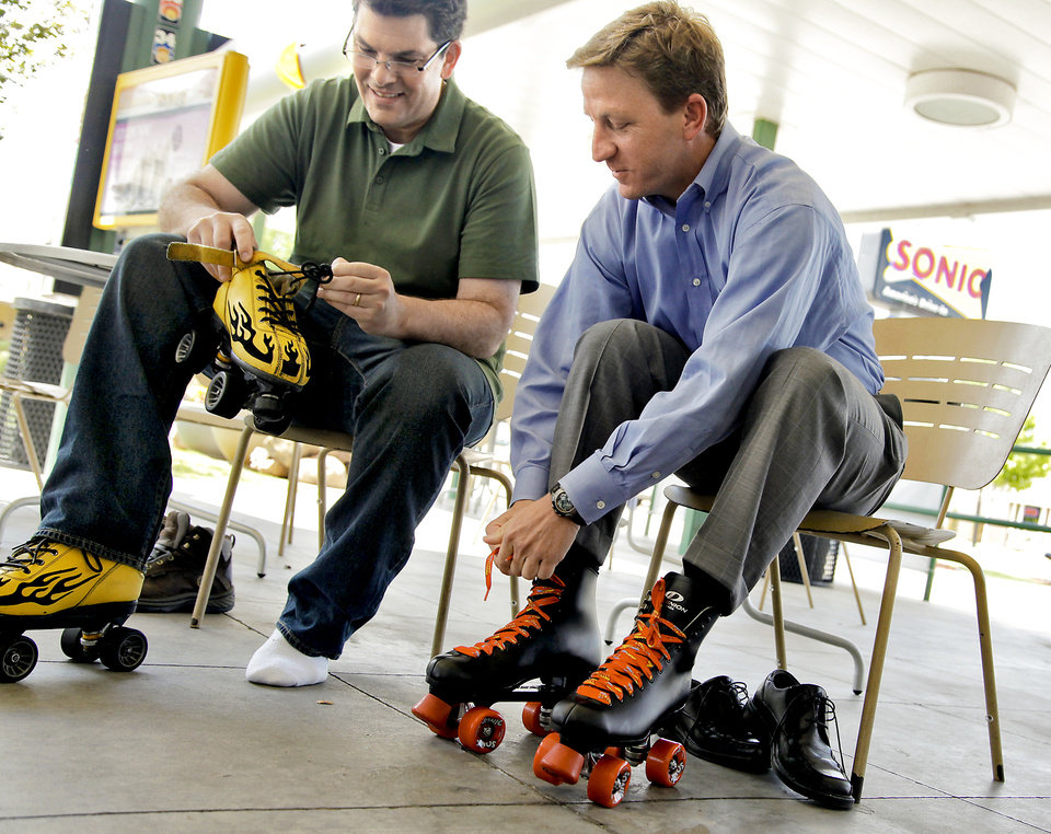 """Fast Food Mania"" host Jon Hein, left, and Sonic's senior director of brand marketing Matt Schein lace up their skates to try their hand at being a car hop during a recent filming of the new show. <strong>CHRIS LANDSBERGER - CHRIS LANDSBERGER</strong>"