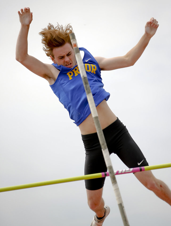 Photo - Pryor's Scott Hill competes in the Class 5A boys pole vault during the Class 6A and 5A state championship track meet at Yukon High School on Saturday, May 17, 2014 in Yukon, Okla.   Photo by Chris Landsberger, The Oklahoman