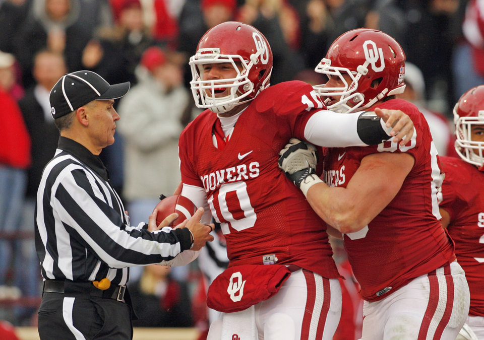 Oklahoma's Blake Bell (10) and Oklahoma's Lane Johnson (69) celebrate a touchdown during a college football game between the University of Oklahoma Sooners (OU) and the Iowa State University Cyclones (ISU) at Gaylord Family-Oklahoma Memorial Stadium in Norman, Okla., Saturday, Nov. 26, 2011. Photo by Steve Sinsey, The Oklahoman