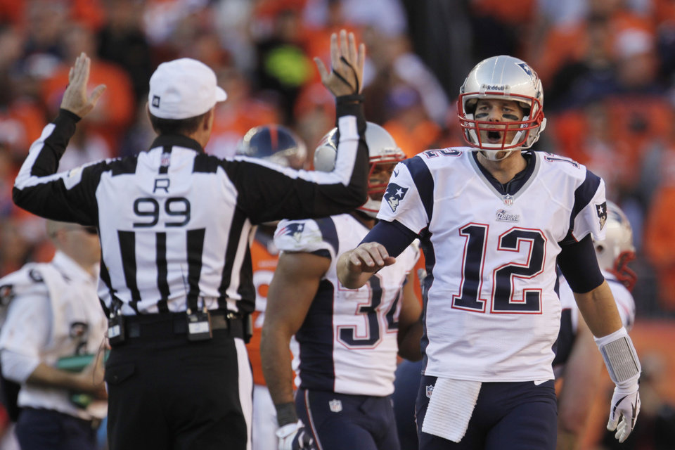 Photo - New England Patriots quarterback Tom Brady (12) reacts to a call by referee Tony Corrente during the second half of the AFC Championship NFL playoff football game against the Denver Broncos in Denver, Sunday, Jan. 19, 2014. (AP Photo/Joe Mahoney)