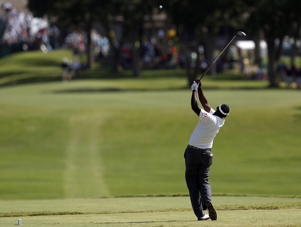 Photo - Vijay Singh tees off the 18th hole in the final round of the U.S. Senior Open golf tournament at Oak Tree National in Edmond, Okla., Sunday, July 13, 2014. Photo by Sarah Phipps, The Oklahoman