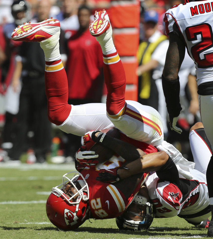 Photo -   Kansas City Chiefs wide receiver Dwayne Bowe (82) is tackled by Atlanta Falcons cornerback Brent Grimes (20) during the first half of an NFL football game at Arrowhead Stadium in Kansas City, Mo., Sunday, Sept. 9, 2012. (AP Photo/Ed Zurga)
