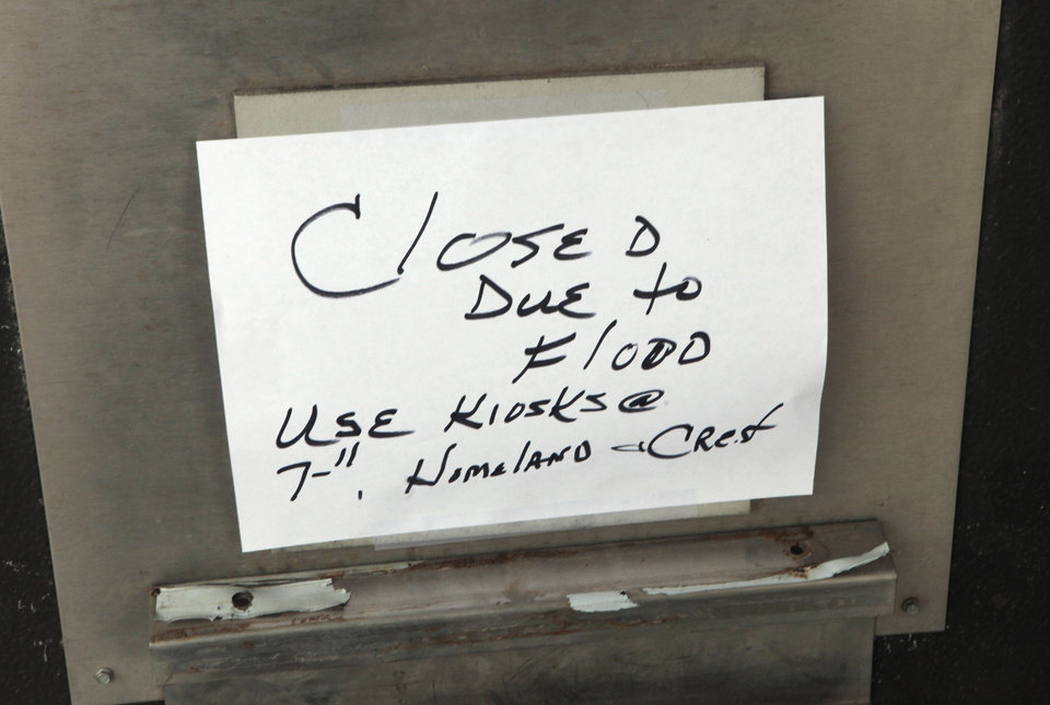 """Closed due to Flooding"" sign on the utility bill payment droop slot in the flooded city office building at 420 West Main, Monday, February 3, 2014. Photo by David McDaniel, The Oklahoman"