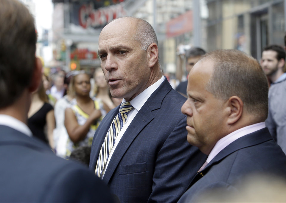 Photo - Anthony Simon, left, lead union negotiator for Long Island Rail Road Union, speaks during a news conference accompanied by union representative Dean Devita, right, in New York on Wednesday, July 16, 2014 after Gov. Andrew Cuomo issued an appeal Wednesday morning for the sides to resume negotiating. MTA and union officials said they agreed to resume negotiating. (AP Photo/Frank Franklin II)