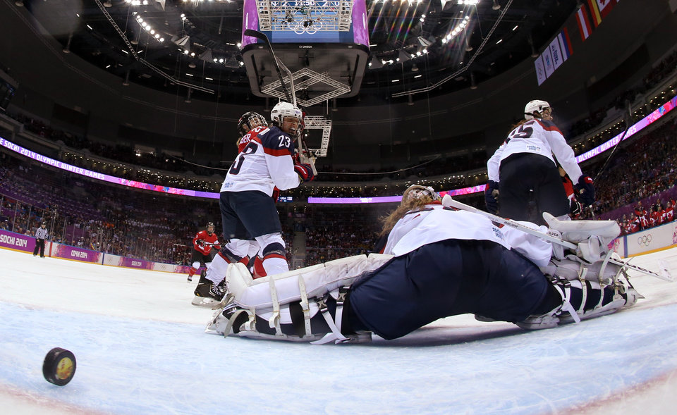 Photo - The puck gets past USA Goalkeeper Jessie Vetter (31) for the game-winning goal against Canada in the women's gold medal ice hockey game at the 2014 Winter Olympics, Thursday, Feb. 20, 2014, in Sochi, Russia. (AP Photo/Martin Rose, Pool)
