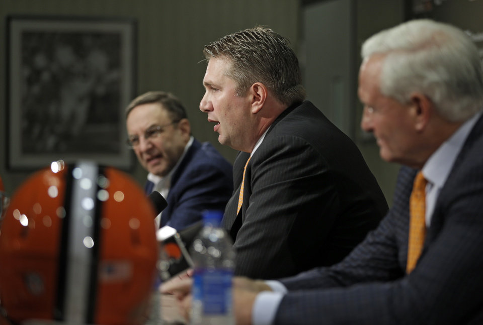 Photo - New Cleveland Browns head coach Rob Chudzinski, center, answers questions at his introductory news conference with CEO Joe Banner, left, and owner Jimmy Haslam at the NFL football team's practice facility in Berea, Ohio Friday, Jan. 11, 2013. Chudzinski becomes the 14th full-time head coach in team history. (AP Photo/Mark Duncan)