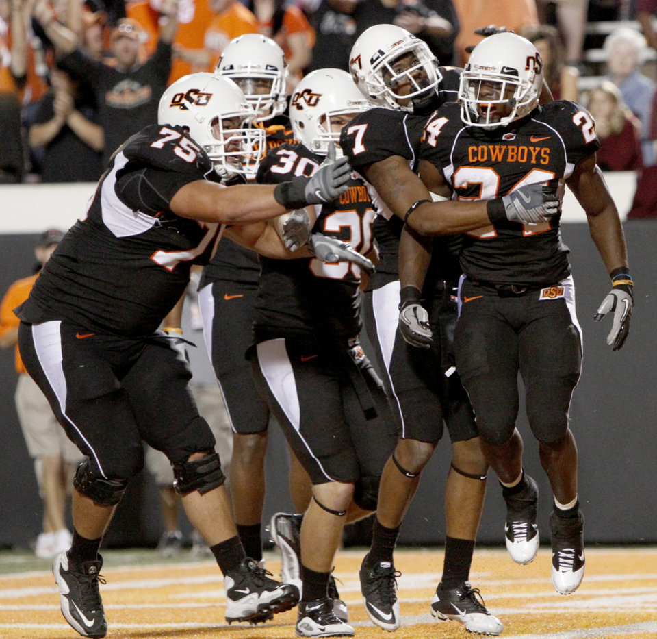 Photo - OSU's Kendall Hunter, right, celebrates after a touchdown during the college football game between Texas A&M University and Oklahoma State University (OSU) at Boone Pickens Stadium in Stillwater, Okla., Thursday, Sept. 30, 2010. Photo by Bryan Terry, The Oklahoman