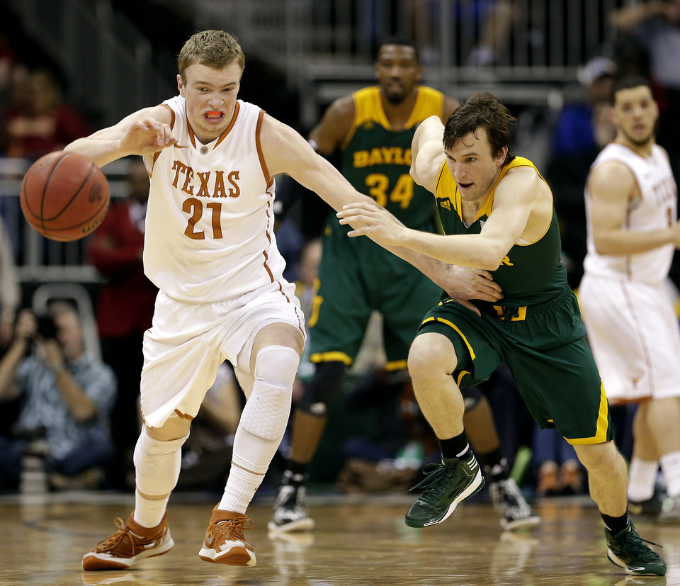 Photo - Texas' Connor Lammert (21) and Baylor's Brady Heslip chase a loose ball during the first half of an NCAA college basketball game in the semifinals of the Big 12 Conference tournament on Friday, March 14, 2014, in Kansas City, Mo. (AP Photo/Charlie Riedel)