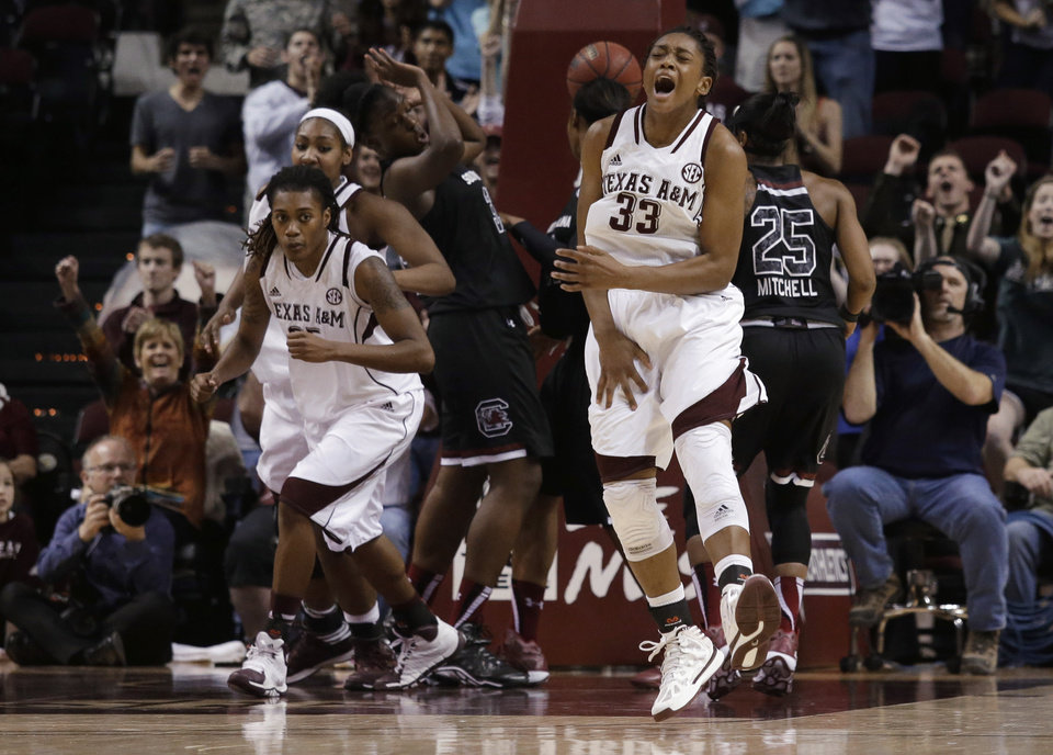 Photo - Texas A&M guard Courtney Walker (33) celebrates after scoring during the second half of an NCAA college basketball game against South Carolina, Thursday, Jan. 16, 2014, in College Station, Texas. Texas A&M defeated South Carolina 67-65. (AP Photo/Patric Schneider)