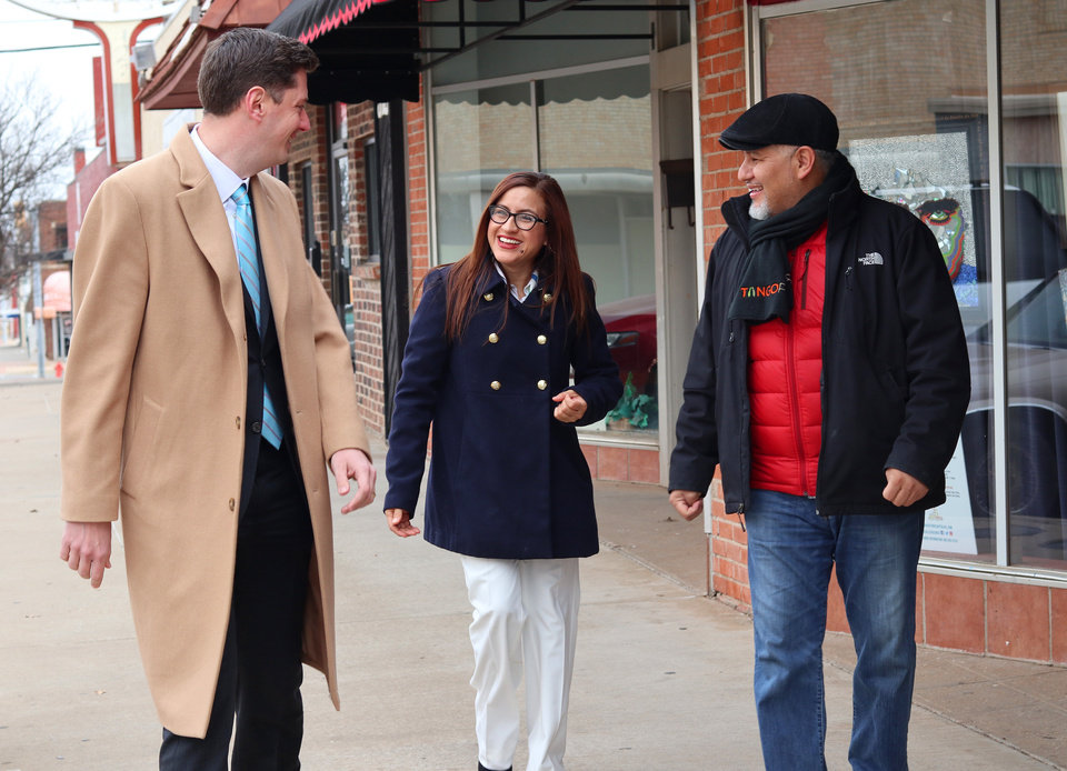 Photo - David Holt, left, met with Jorge and Brenda Hernandez in Capitol Hill before the Feb. 13 primary election. Holt drew 78.5 percent of the vote in a three-way race and will take office April 10. [Photo by Doug Hoke, The Oklahoman]