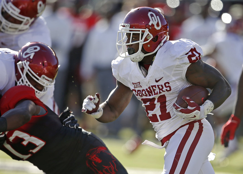 Photo - Oklahoma's Keith Ford (21) runs during a college football game between the University of Oklahoma Sooners (OU) and the Texas Tech Red Raiders at Jones AT&T Stadium in Lubbock, Texas, Saturday, November 15, 2014.  Photo by Bryan Terry, The Oklahoman
