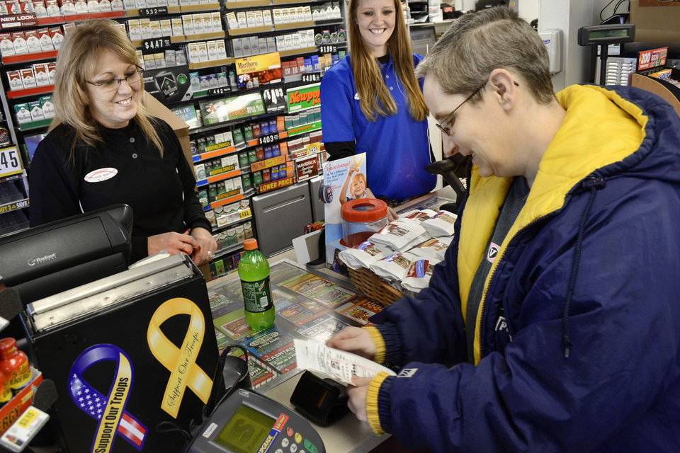 Manager Julie Rebennack, left, and customer service representative Megan Horn wish Lori Soule, 48, right, good luck after Soule purchased a Powerball ticket Monday, Nov. 26, 2012, at a Speedway convenience store in Marion, Ind. Wednesday\'s Powerball jackpot will be a predicted $425 million, the game\'s largest jackpot ever. (AP Photo/The Chronicle-Tribune, Jeff Morehead)
