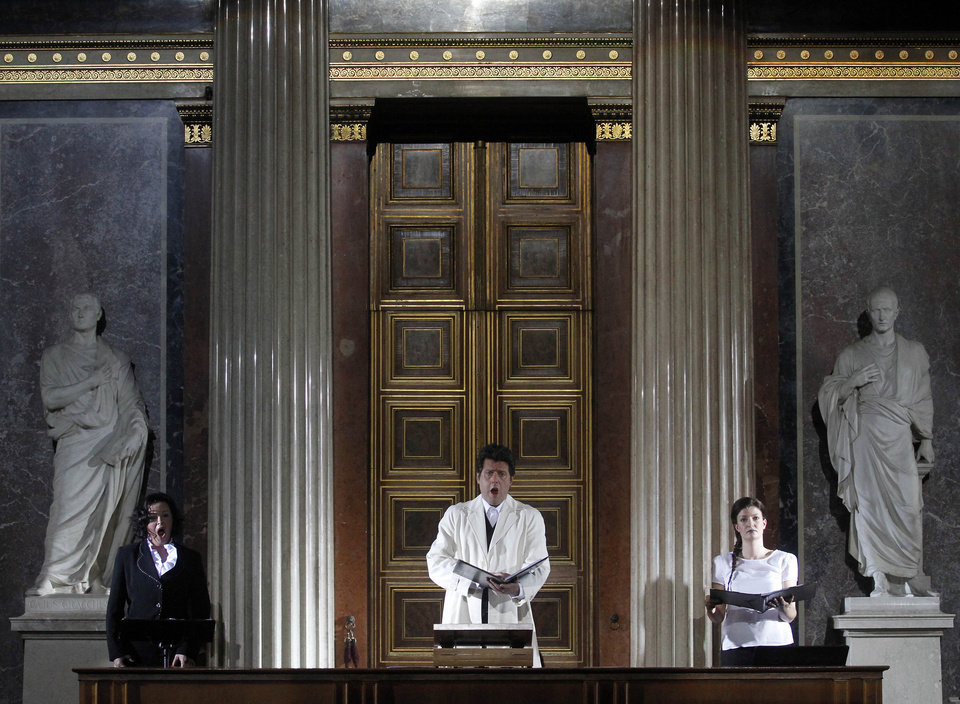 Photo - TO GO WITH HOLOCAUST OPERA STORY BY GEORGE JAHN - Katerina Beranova, Robert Holzer and Silke Doerner, from left, perform during the opera  'Spiegelgrund ' by Austrian composer Peter Androsch in the imperial council hall of the Austrian parliament in Vienna, Friday, Jan. 25, 2013. Androsch goes where few others have dared, with an opera depicting how Nazis methodically killed mentally or physically deficient children. The performance premieres to mark International Holocaust Day in the parliament of Austria, a nation still atoning for its role in atrocities committed by the Nazis. (AP Photo/Ronald Zak)