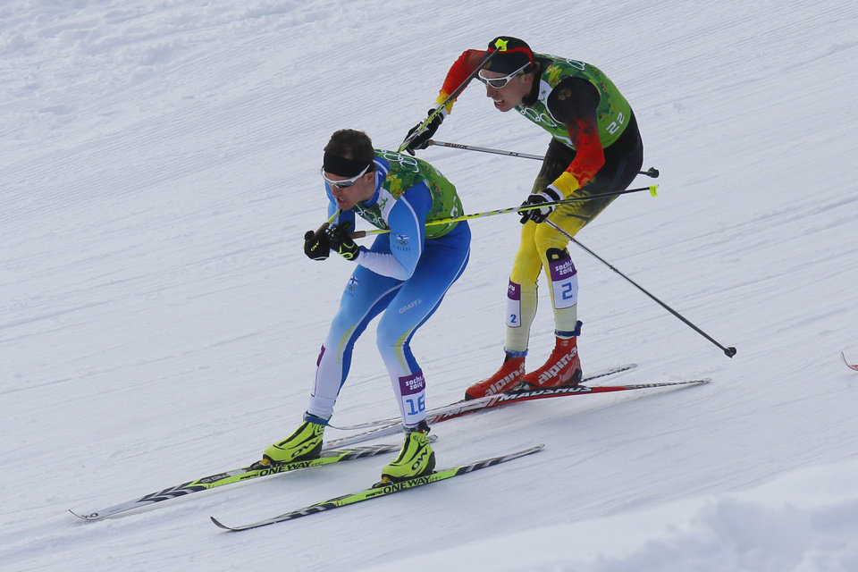 Photo - Germany's Tim Tscharnke, right, makes contact with the skis of Finland's Sami Jauhojaervi, left, before falling in the men's classical-style final of the cross-country team sprint competitions at the 2014 Winter Olympics, Wednesday, Feb. 19, 2014, in Krasnaya Polyana, Russia. (AP Photo/Dmitry Lovetsky)
