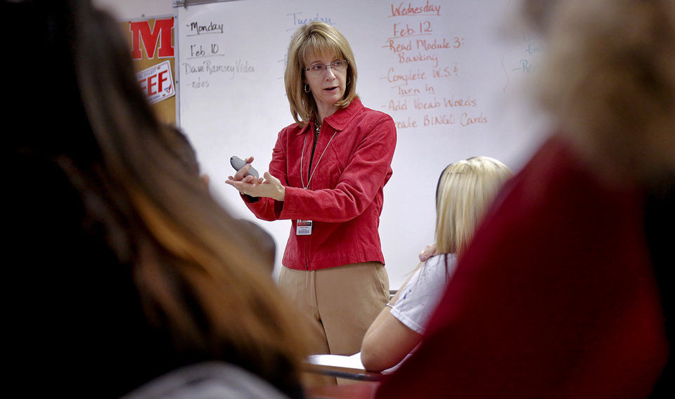 Photo -      Teacher Carrie Hixon gives a lecture during a financial literacy class at Mustang High School.  Students in the state of Oklahoma must understand financial concepts in order to graduate. Photo by Chris Landsberger, The Oklahoman   CHRIS LANDSBERGER - CHRIS LANDSBERGER