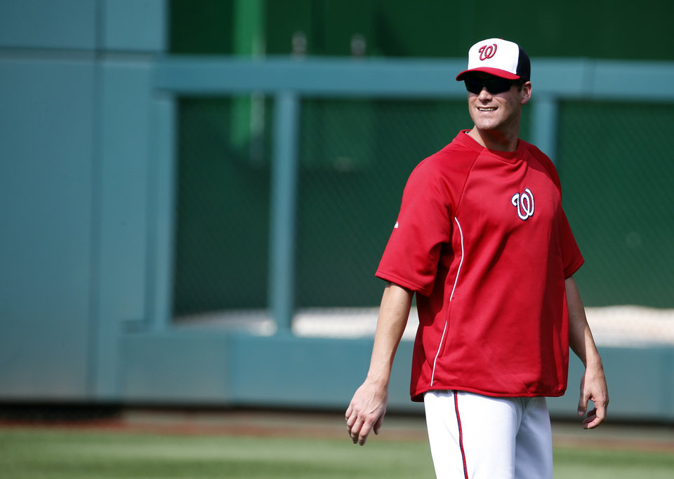 Photo - Washington Nationals pitcher Matt Thornton walks on the field before a baseball game against the New York Mets at Nationals Park Wednesday, Aug. 6, 2014, in Washington. Thornton was acquired on a waiver claim from the New York Yankees on Tuesday. (AP Photo/Alex Brandon)