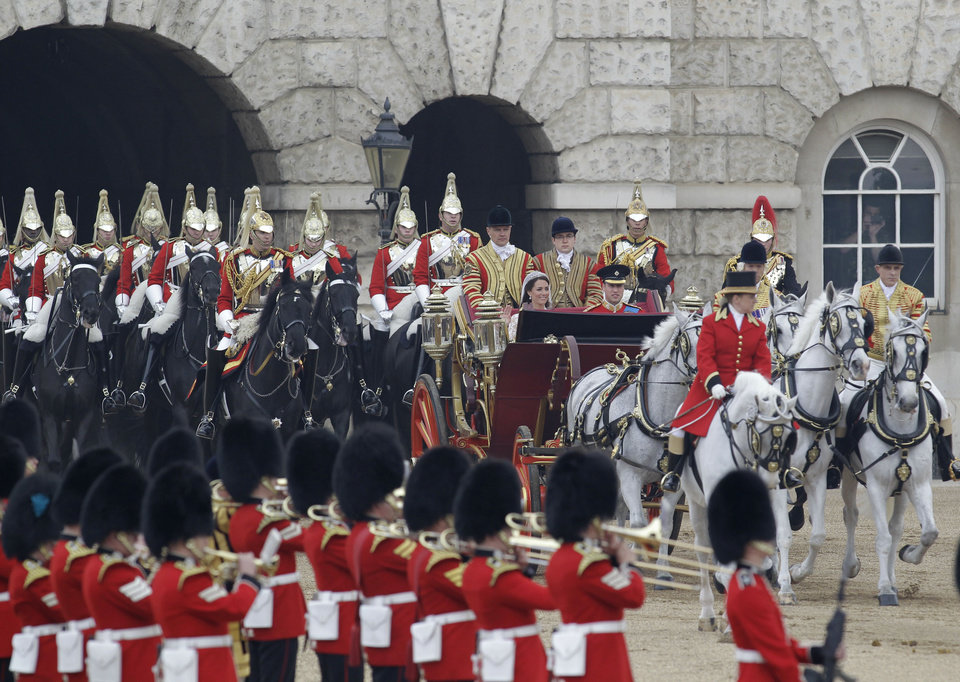 Photo - Britain's Prince William and his wife Kate, Duchess of Cambridge pass through Horse Guards, travel enroute to Buckingham Palace following their marriage at Westminster Abbey  in London, Friday, April 29, 2011. (AP Photo/Sang Tan, Pool) ORG XMIT: LST117