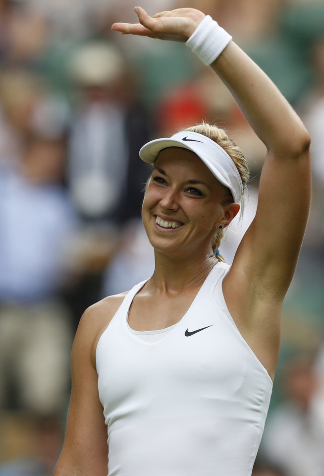 Photo - Sabine Lisicki of Germany celebrates winning her first round match against Julia Glushko of Israel at the All England Lawn Tennis Championships in Wimbledon, London, Tuesday, June 24, 2014. (AP Photo/Sang Tan)