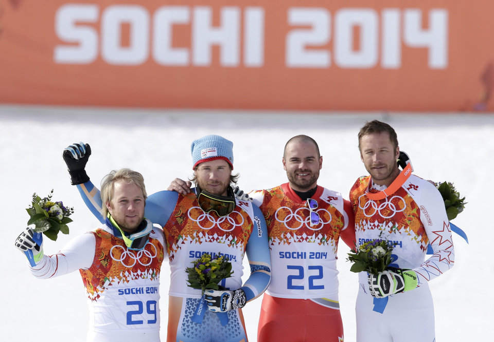 Photo - Men's super-G medalists from left, United States' Andrew Weibrecht (silver), Norway's Kjetil Jansrud (gold), Canada's Jan Hudec (bronze) and United States' Bode Miller (bronze) stand on the podium for a flower ceremony at the Sochi 2014 Winter Olympics, Sunday, Feb. 16, 2014, in Krasnaya Polyana, Russia.(AP Photo/Gero Breloer)