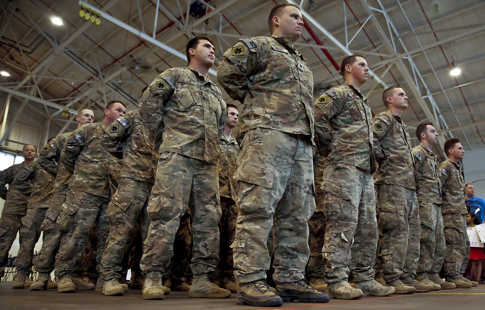 Soldiers stand in formation during the return ceremony for the National Guard\'s 45th Infantry Brigade Combat Team troops at the National Guard Base on Thursday, March 15, 2012, in Oklahoma City, Oklahoma. Photo by Chris Landsberger, The Oklahoman