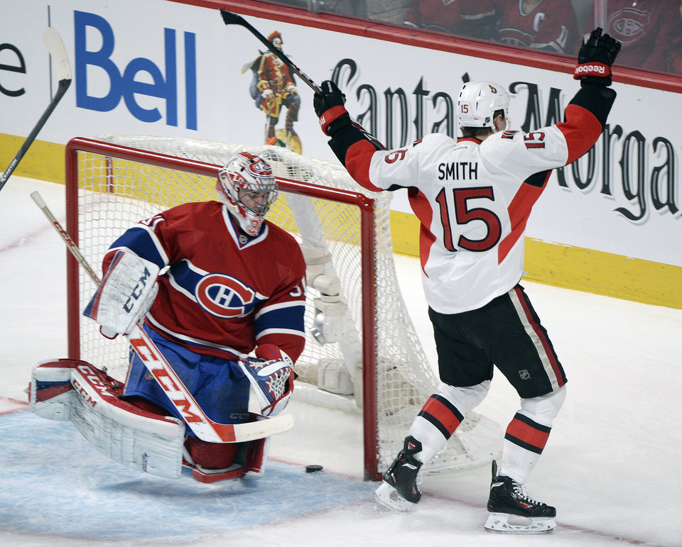 Photo - Ottawa Senators' Zack Smith celebrates a goal scored by teammate Erik Condra against Montreal Canadiens goaltender Carey Price, left, during the first period of an NHL hockey game in Montreal, Saturday, Jan. 4, 2014. (AP Photo/The Canadian Press, Graham Hughes)