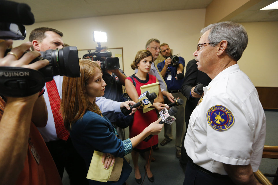 Photo - Nichols Hills Fire Chief Terry Hamilton talks with news reporters Tuesday after the sentencing for Rebecca Bryan.  Steve Gooch - The Oklahoman