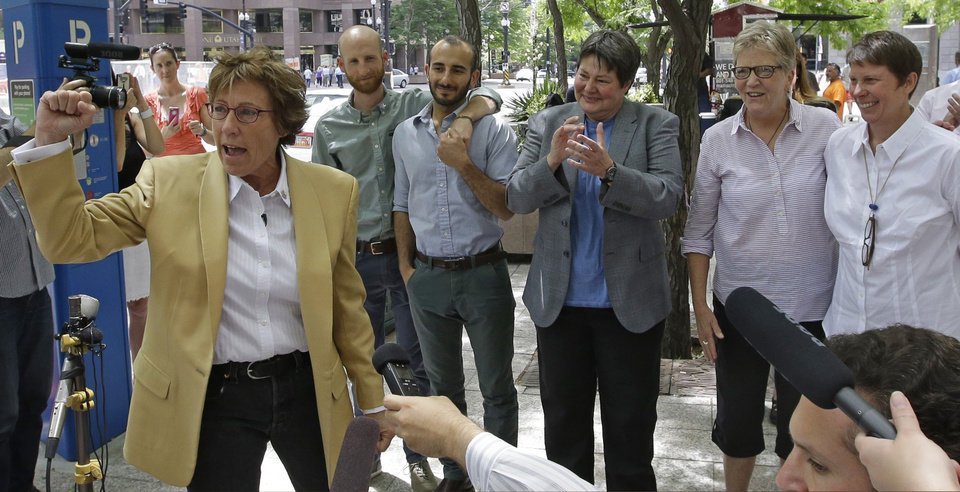 Photo - Peggy Tomsic, left, attorney for Moudi Sbeity and Derek Kitchen, Kate Call, Laurie Wood and Kody Partridge, five of the six people who brought the lawsuit against the Utah's gay marriage ban, speaks during a news conference in Salt Lake City on Wednesday, June 25, 2014. On Wednesday, a federal appeals court ruled that states must allow gay couples to marry, finding the Constitution protects same-sex relationships. The decision from a three-judge panel in Denver upheld a lower court ruling that struck down Utah's gay marriage ban. (AP Photo/Rick Bowmer)