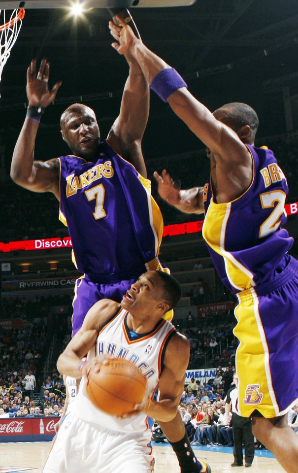 Photo - Oklahoma City's Russell Westbrook (0) works underneath the defense of Lamar Odom (7) and Kobe Bryant (24) of Los Angeles during the NBA basketball game between the Los Angeles Lakers and the Oklahoma City Thunder at the Ford Center in Oklahoma City, Friday, March 26, 2010. Oklahoma City won, 91-75. Photo by Nate Billings, The Oklahoman
