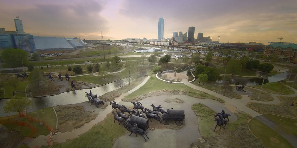 The Land Run Monument is seen in the foreground, with the downtown Oklahoma City skyline in back, in this photo taken from Price Edwards & Co.'s drone. <strong> - PROVIDED BY PRICE EDWARDS & CO.</strong>