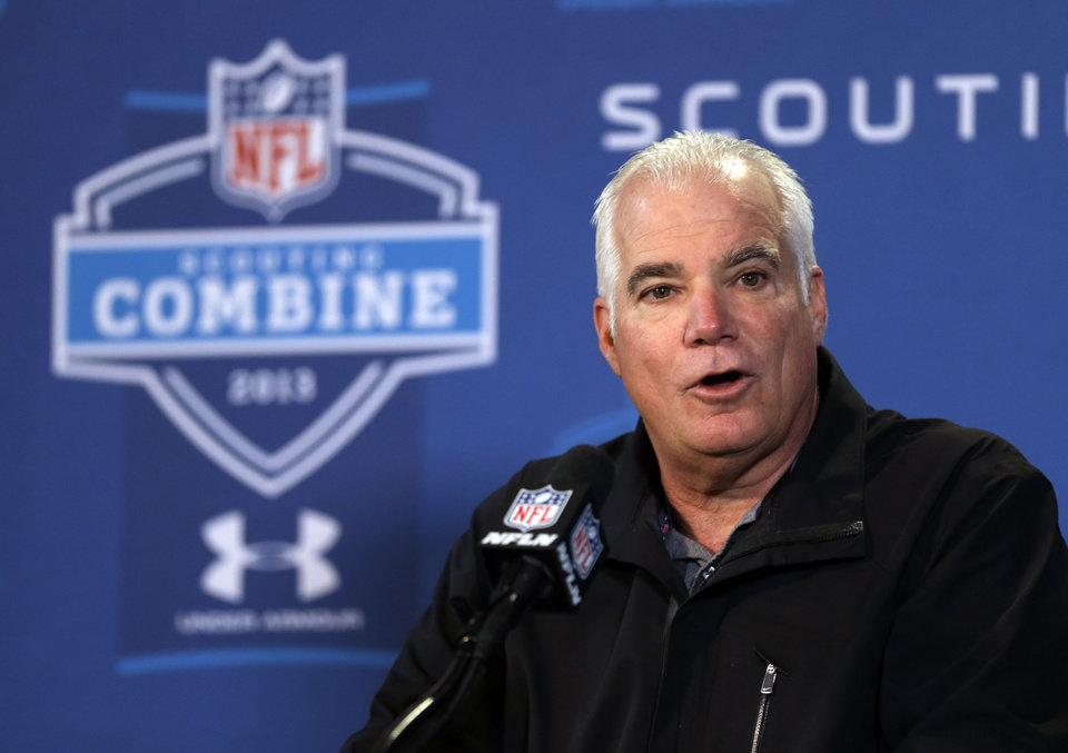 Atlanta Falcons head coach Mike Smith answers a question during a news conference at the NFL football scouting combine in Indianapolis, Friday, Feb. 22, 2013. (AP Photo/Michael Conroy)