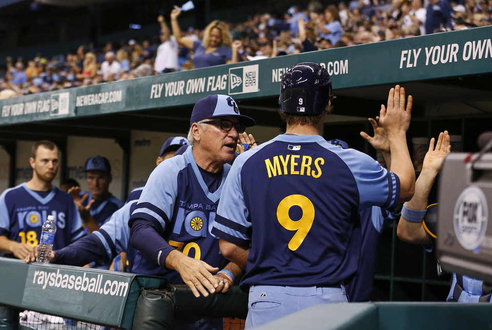 Photo - Tampa Bay Rays manager Joe Maddon, left, congratulates Wil Myers after he scored during the sixth inning of a baseball game against the Chicago White Sox Saturday, July 6, 2013, in St. Petersburg, Fla. (AP Photo/Mike Carlson)