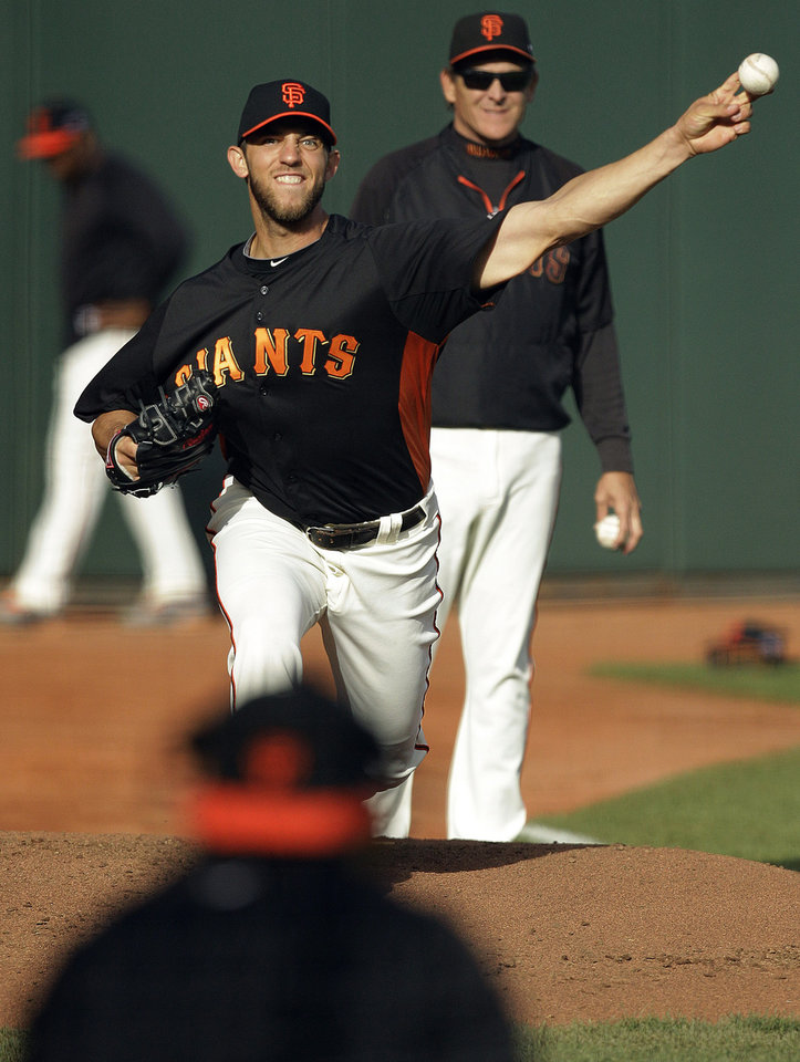 San Francisco Giants' Madison Bumgarner pitches in preparation for the National League division baseball series against the Cincinnati Reds, Thursday, Oct. 4, 2012, in San Francisco. Bumgarner will start Game 2 for the Giants. (AP Photo/Ben Margot)
