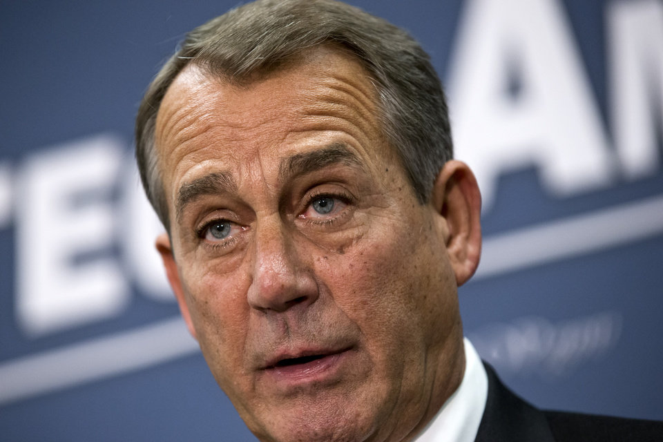 Photo - Speaker of the House John Boehner, R-Ohio, joined by the Republican leadership speaks to reporters about the fiscal cliff negotiations with President Obama following a closed-door strategy session, at the Capitol in Washington, Tuesday, Dec. 18, 2012.  (AP Photo/J. Scott Applewhite)