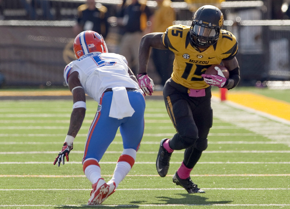 Photo - Missouri wide receiver Dorial Green-Beckham runs with the ball as Florida Gators defensive back Marcus Roberson defends during the fourth quarter of an NCAA college football game Saturday, Oct. 19, 2013, in Columbia, Mo. (AP Photo/L.G. Patterson)