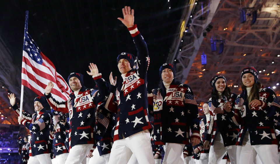 Photo - FILE - This Feb. 7, 2014 file photo shows the United States team arrives during the opening ceremony of the 2014 Winter Olympics in Sochi, Russia. Ralph Lauren's love for the American flag and American style earned him high honors Tuesday, June 17, from the Smithsonian Institution, celebrating his five decades in fashion. Lauren designed the uniforms for the US Winter Olympic team. (AP Photo/Patrick Semansky, File)