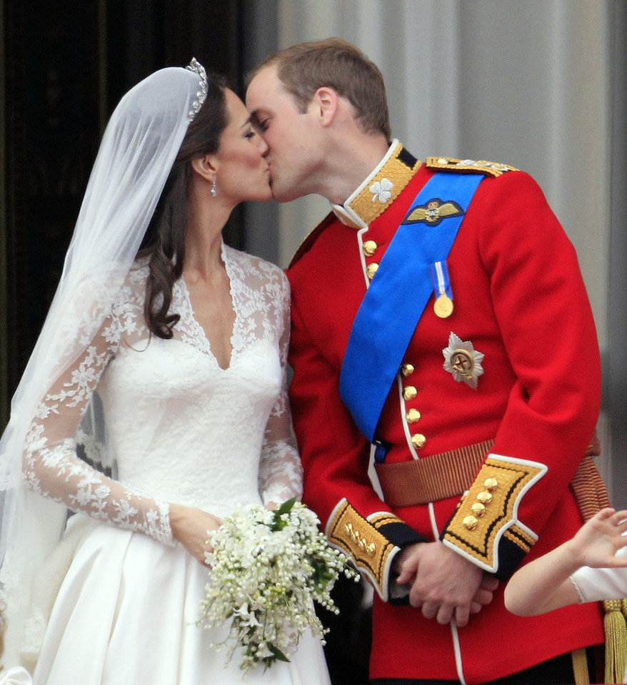 Photo - Britain's Prince William kisses his wife Kate, Duchess of Cambridge on the balcony of Buckingham Palace after the Royal Wedding in London Friday, April, 29, 2011. (AP Photo/Matt Dunham) ORG XMIT: RWMG177