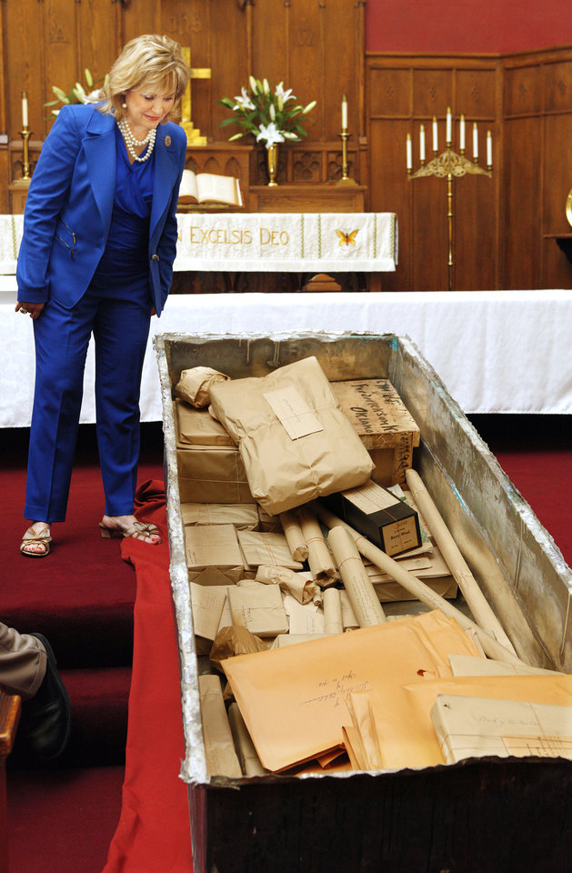 Gov. Mary Fallin looks inside the Century Chest after the lid was removed at First Lutheran Church in Oklahoma City Monday, April 22, 2013. The Century Chest is a time capsule put together and buried April 22, 1913 by the church. Photo by Paul B. Southerland, The Oklahoman