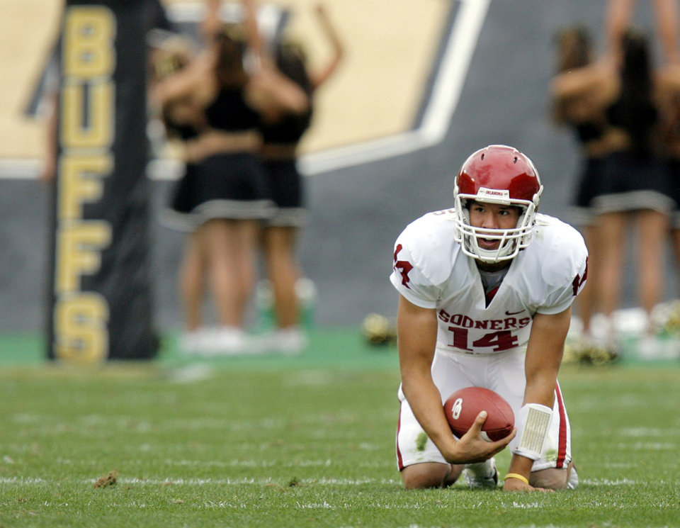 Photo - OU's Sam Bradford gets up after being sacked in the second half of the college football game between the University of Oklahoma Sooners (OU) and the University of Colorado Buffaloes (CU) at Folsom Field in Boulder, Co., on Saturday, Sept. 28, 2007. Colorado won, 27-24. By NATE BILLINGS, The Oklahoman