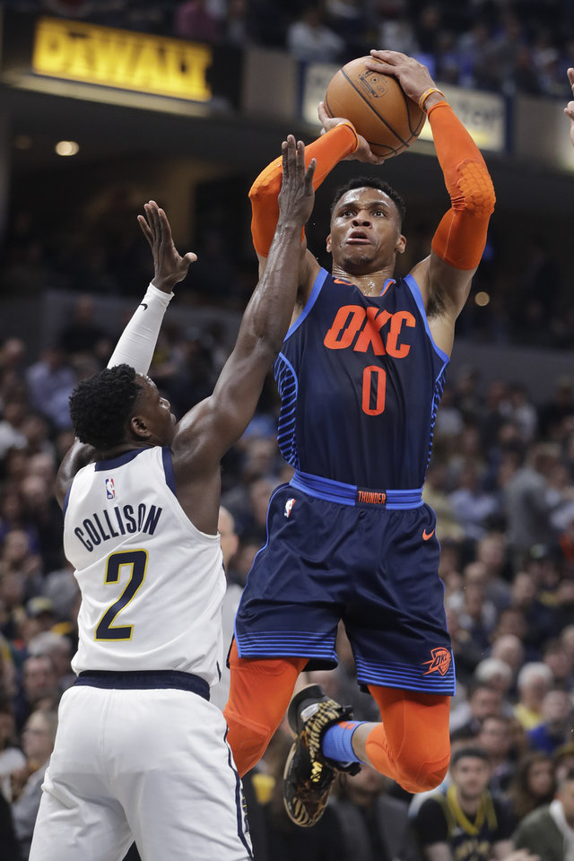 Photo - Oklahoma City Thunder's Russell Westbrook (0) shoots over Indiana Pacers' Darren Collison (2) during the first half of an NBA basketball game, Thursday, March 14, 2019, in Indianapolis. (AP Photo/Darron Cummings)