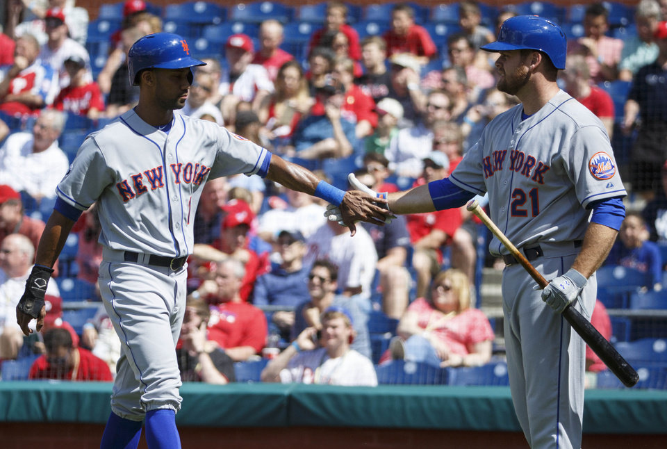 Photo - New York Mets' Chris Young, left, celebrates his run scored with Lucas Duda, right, during the first inning of a baseball game against the Philadelphia Phillies, Saturday, May 31, 2014, in Philadelphia. (AP Photo/Chris Szagola)