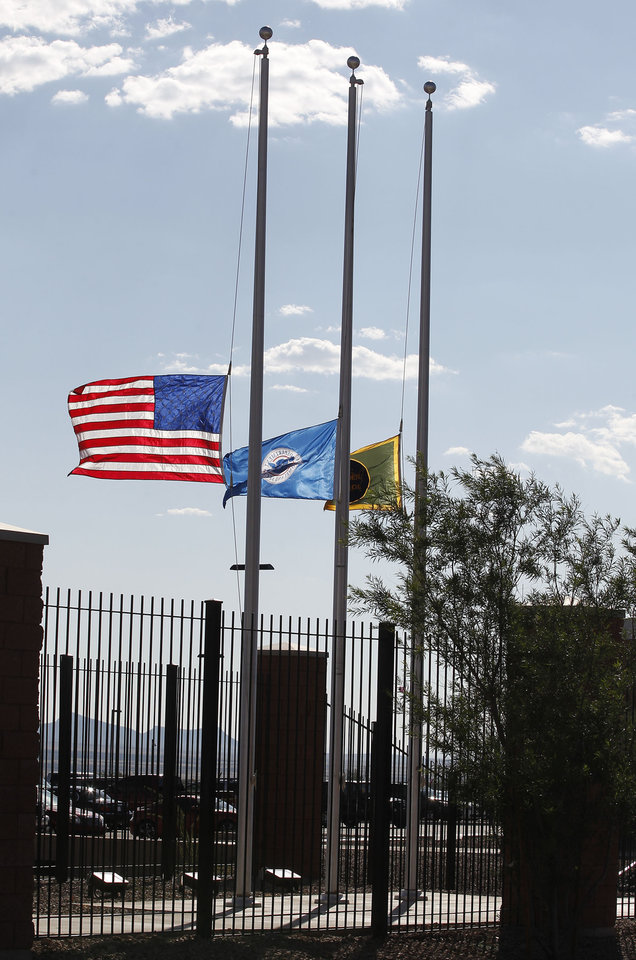 Hours after U.S. Border Patrol agent Nicholas Ivie was shot and killed, and one other was shot and injured, flags fly at half staff at the U.S. Customs and Border Protection Brian A. Terry Border Patrol Station Tuesday, Oct. 2, 2012, in Bisbee, Ariz. (AP Photo/Ross D. Franklin)