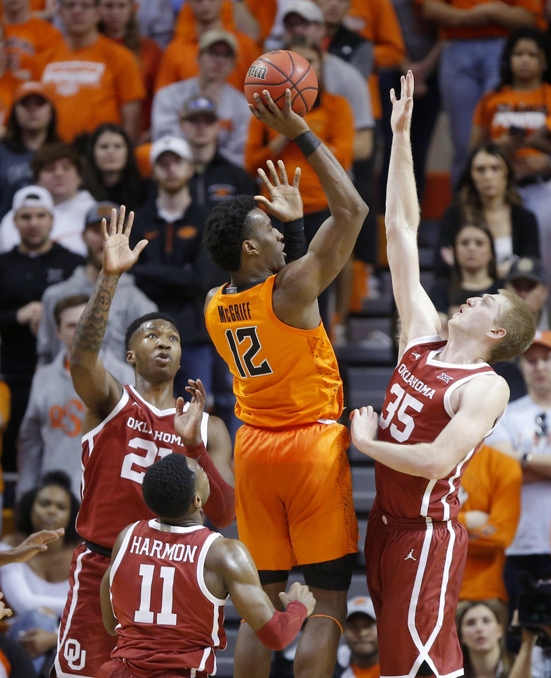 Photo - Oklahoma State's Cameron McGriff (12) makes a basket as Oklahoma's Kristian Doolittle (21), De'Vion Harmon (11) and Brady Manek (35) defend during an NCAA men's Bedlam basketball game between the Oklahoma State University Cowboys (OSU) and the University of Oklahoma Sooners (OU) at Gallagher-Iba Arena in Stillwater, Okla., Saturday, Feb. 22, 2020. Oklahoma State won 83-66. [Bryan Terry/The Oklahoman]