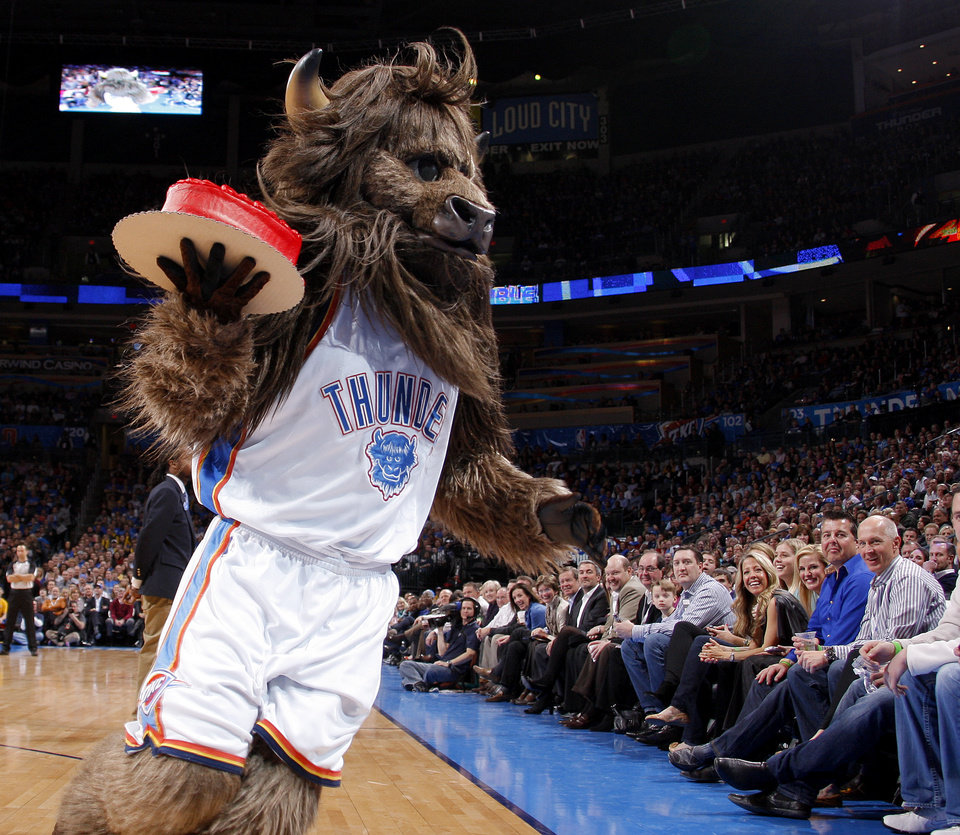 Photo - Rumble the Bison carries a cake for Valentine's during an NBA game between the Oklahoma City Thunder and the Utah Jazz at Chesapeake Energy Arena in Oklahoma CIty, Tuesday, Feb. 14, 2012. Photo by Bryan Terry, The Oklahoman