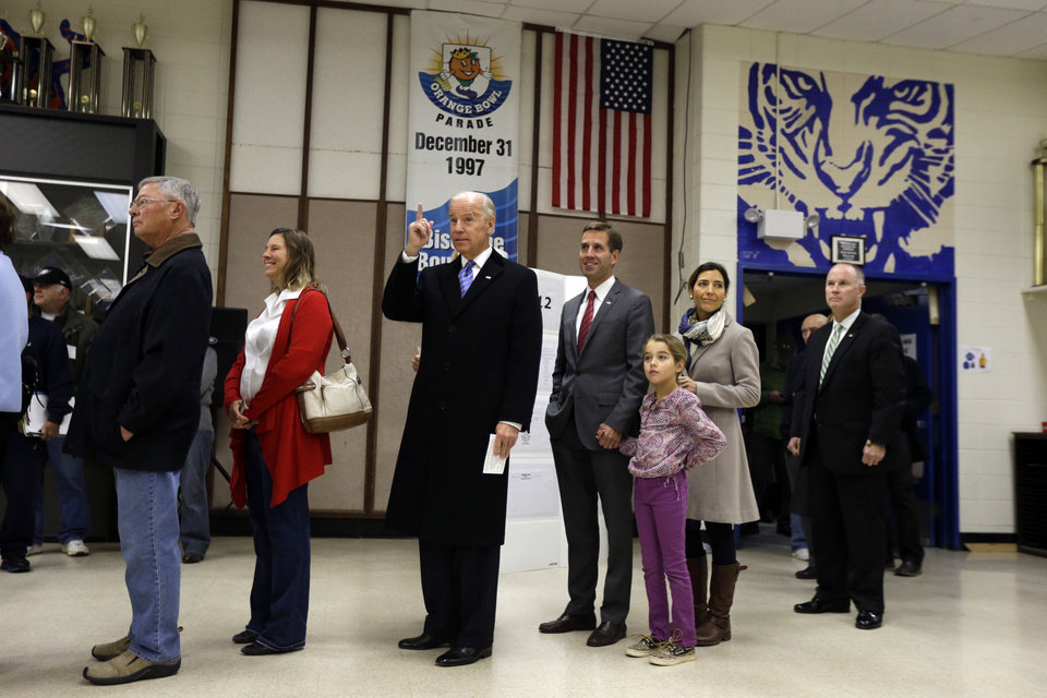 Vice President Joe Biden, accompanied by his son Beau Biden, his wife, Hallie and their daughter Natalie, stands in line to cast his ballot at Alexis I. duPont High School, Tuesday, Nov. 6, 2012, in Greenville, Del. (AP Photo/Matt Rourke)