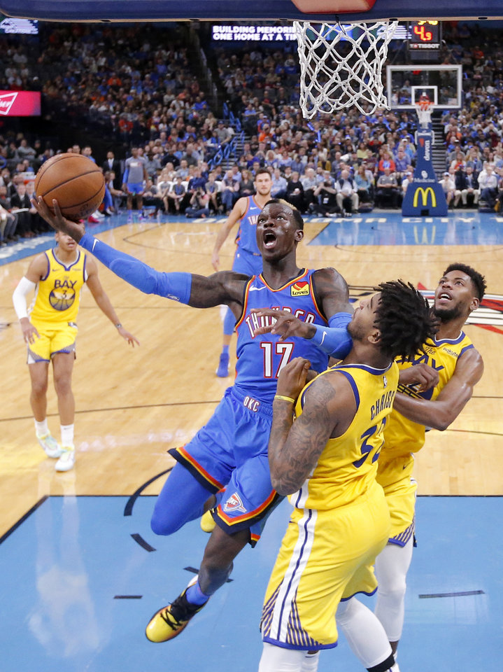 Photo - Oklahoma City's Dennis Schroder (17) goes up for a lay up as Golden State's Marquese Chriss (32) defends during the NBA game between the Oklahoma City Thunder and the Golden State Warriors at Chesapeake Energy Arena,   Saturday, Nov. 9, 2019.  [Sarah Phipps/The Oklahoman]