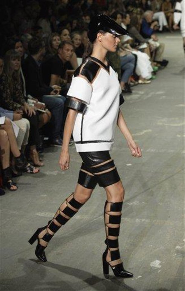 Photo - FILE - This Sept. 8, 2012 file photo shows the Alexander Wang Spring 2013 collection being modeled during Fashion Week in New York. Tweaking your makeup routine is something you probably could do today because it's changing how you wear the products more than a change in products themselves, says Linda Wells, editor in chief of Allure. (AP Photo/Richard Drew, file)