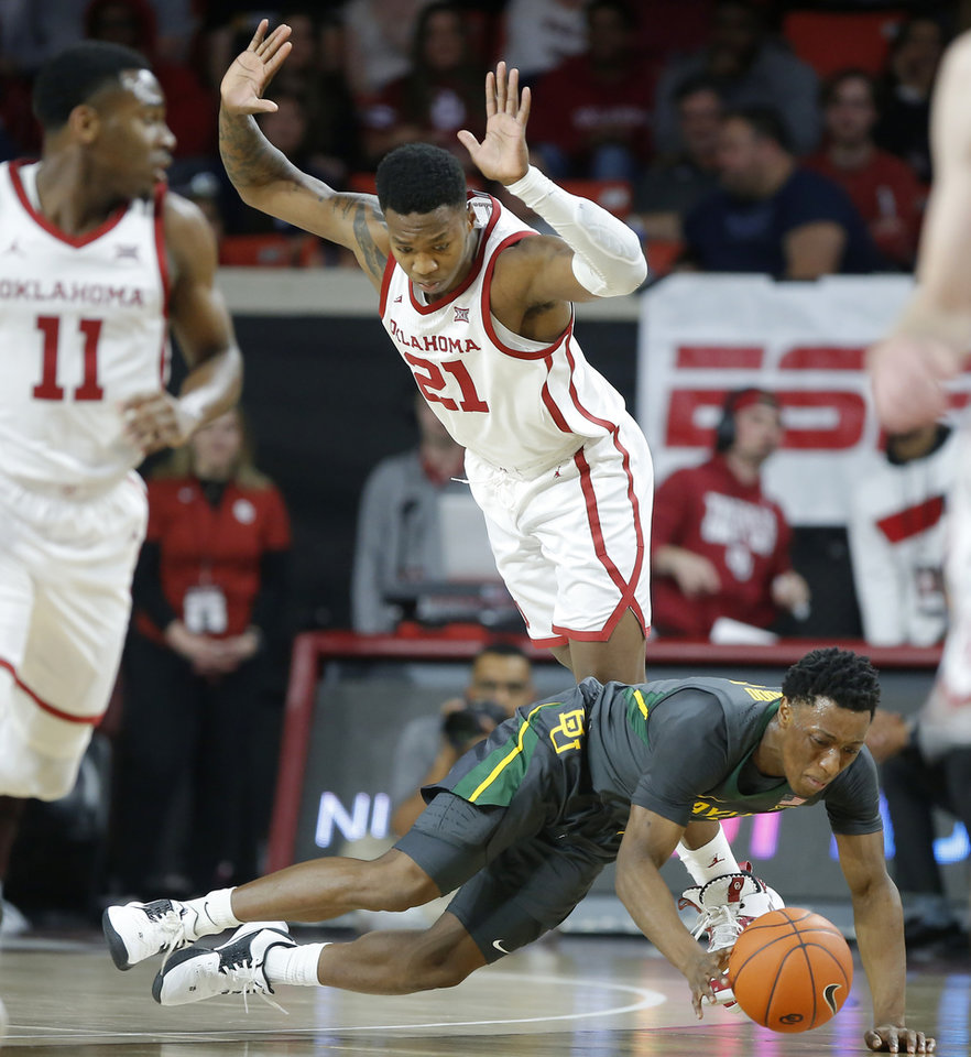 Photo - Baylor's Devonte Bandoo (2) falls down in front of Oklahoma's Kristian Doolittle (21) during a men's NCAA basketball game between the University of Oklahoma Sooners (OU) and the Baylor Bears at the Lloyd Noble Center in Norman, Okla., Tuesday, Feb. 18, 2020. [Bryan Terry/The Oklahoman]